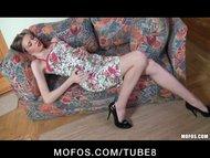 A horny babe lying on the sofa