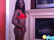 Sexy ebony in red bikini ...