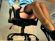 Sexy underdesk tease showing stockings over nylons
