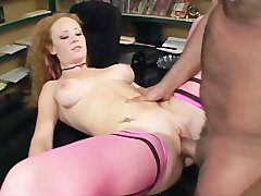 Redhead has sex in pink seamed stockings and heels