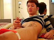 Asian gay strokes his coc...
