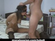 Blindfolded Asian babe gi...