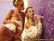 Two blonde brides getting...