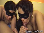 Masked brunettes sucking ...