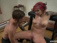 Redheaded female sex slave with big tits in hot wax play