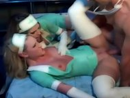 Two latex nurses in unifo...