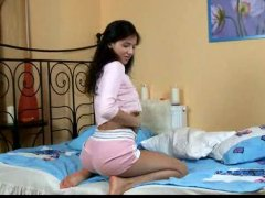 Puffy titted teen Dinara toys her pussy