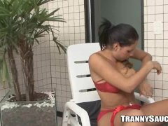 Foxy tranny babe plays with her cock by the pool