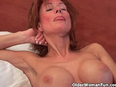 Sultry grandma probes her old pussy with a dildo