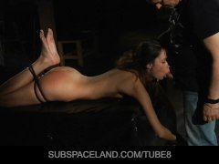Beautiful slave girl in a bondage hard play