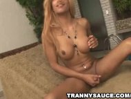 Blonde tranny tugging on ...