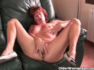 Redheaded mature mom play...